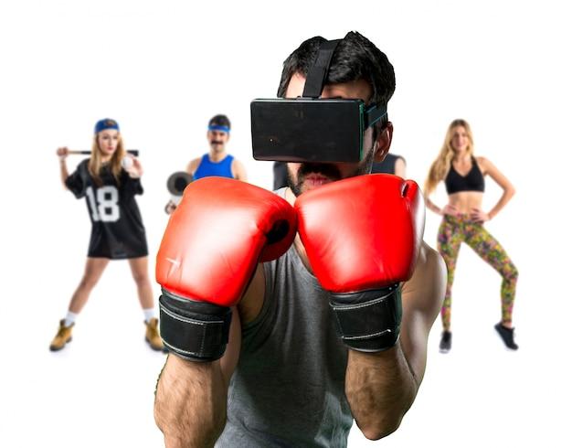 Sportman met bokshandschoenen en vr-bril Premium Foto