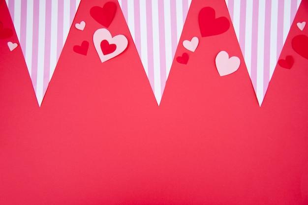St. valentine's party-viering op rode achtergrond Gratis Foto