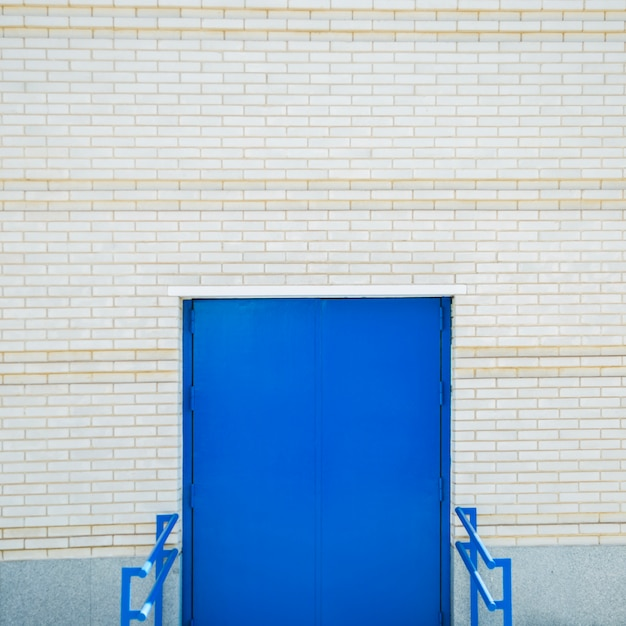 Stadsmuur met deur Gratis Foto