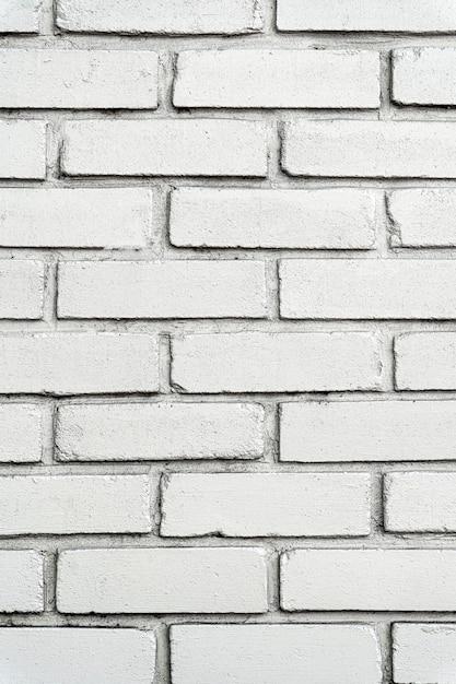 Stedelijke witte bakstenen muur met grote tegels Premium Foto