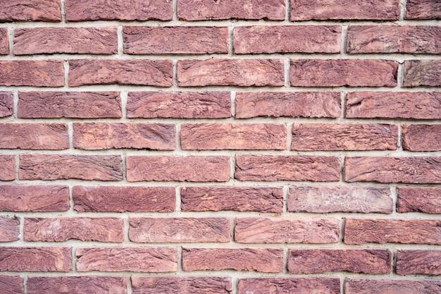 Stenen muur. textuur van rode baksteen met witte vulling Gratis Foto