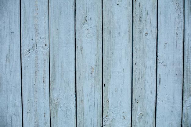 Stock foto van een geschilderde houten gestructureerde achtergrond van een schuur. lichtblauwe houten planken. Gratis Foto