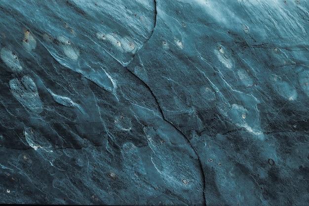 Stone texture achtergrond met gebarsten streak. Premium Foto