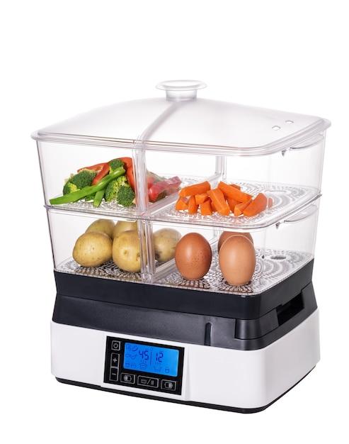 Stoomboot voor groenten en gezonde voeding. vegetarisme. dubbele ketel in wit Premium Foto