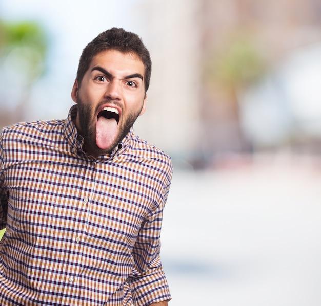 Stressed man met zijn tong uit Gratis Foto