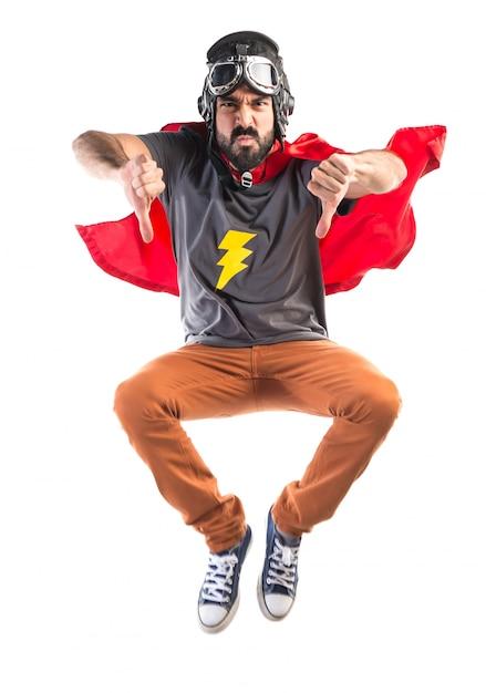 Superhero doet slecht signaal Gratis Foto