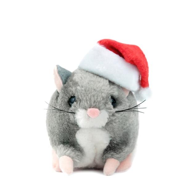 Symbool van de rat van 2020 op een witte geïsoleerde achtergrond in een kerstmuts Premium Foto