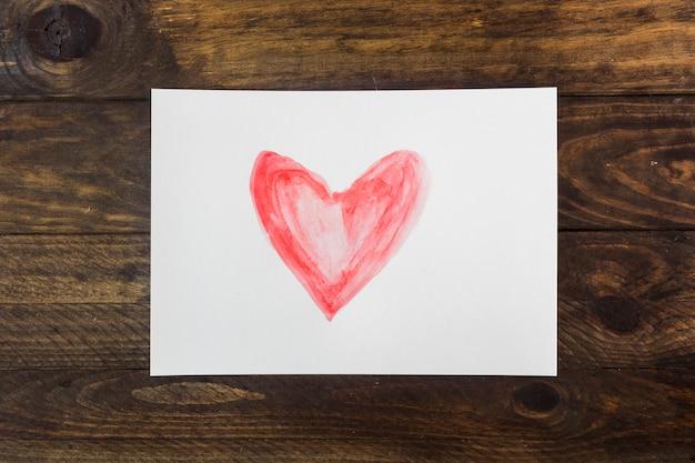 Symbool van hart op wit blad Gratis Foto