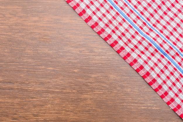 Tafelkleed op houten achtergrond Gratis Foto