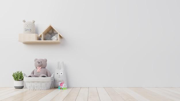 Teddybeer en konijnpop in de kinderkamer op de muur Premium Foto