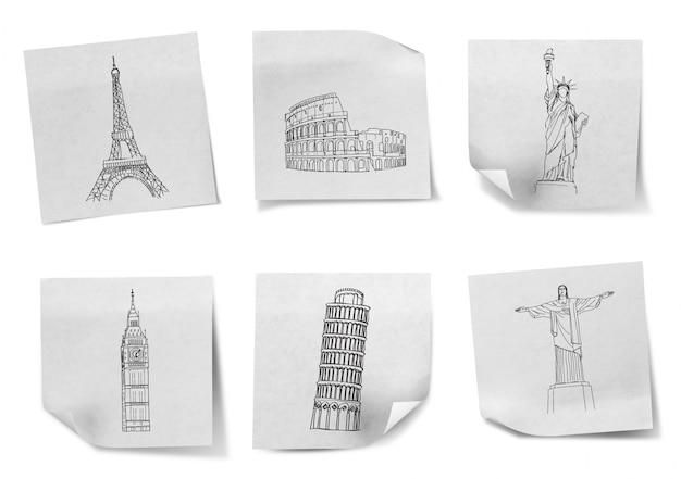 Tekening reizen rond de wereld op een witte notitieblaadjes (frankrijk, het Gratis Foto