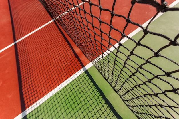 Tennisnet op een tennisbaanachtergrond Premium Foto