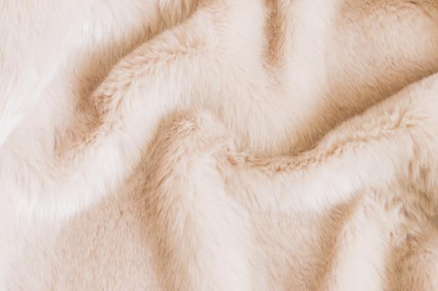 Textuur van beige ruwharig bont. dierlijke textuur Premium Foto