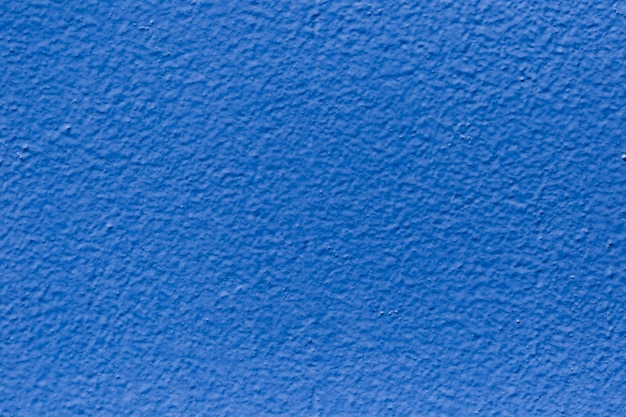Textuur van dichte omhoog geschilderde muur Gratis Foto