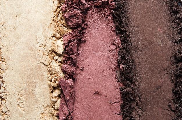Textuur van gebroken oogschaduw of poeder. het concept van mode- en schoonheidsindustrie. detailopname. - afbeelding Premium Foto