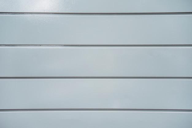 Textuur van lichtgrijze plastic paneelmuur Gratis Foto