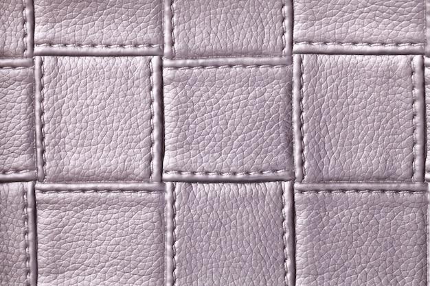 Textuur van paars leer met vierkant patroon en steek Premium Foto