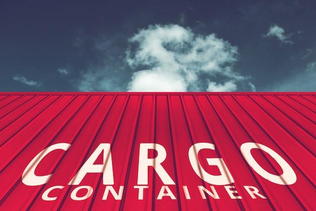 Textuur van rode vrachtschipcontainer die met blauwe hemel wordt gevestigd Premium Foto