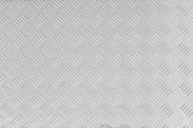 Textuur van roestvrijstalen vloerplaat, metalen plaat met ruwe motieven. patroon van gestripte vierkanten Premium Foto