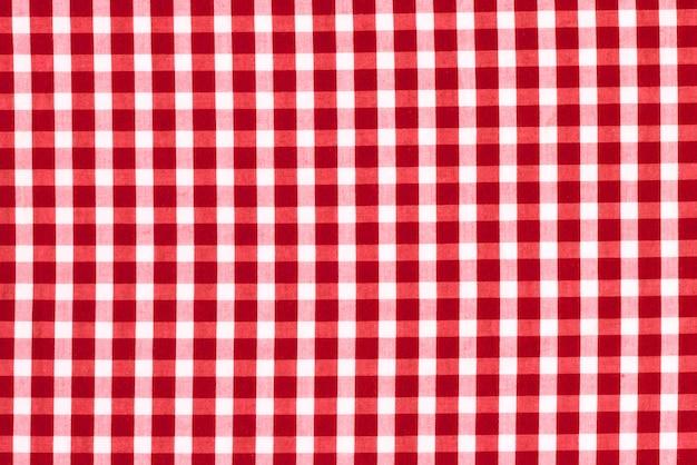 Textuur van stof in een kooi. rode en witte geruite stof. Premium Foto