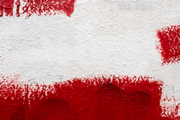 Textuurmuur, druppelverf, stopverf, rood-witte muur Premium Foto