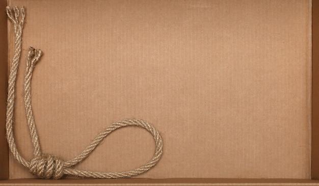 Touw op kartonnen textuur achtergrond Premium Foto