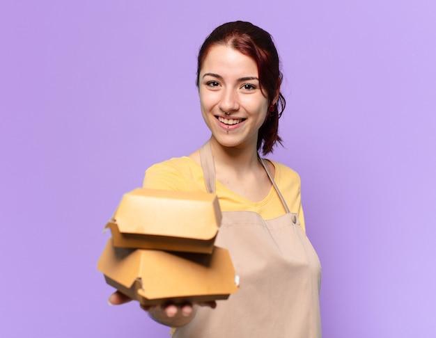 Tty vrouw met een schort. afhaal hamburger bezorg concept Premium Foto