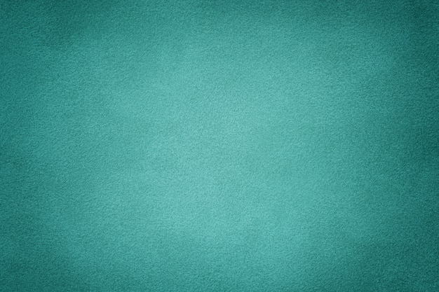 Turquoise matte suède stof achtergrond. fluwelen textuur. Premium Foto