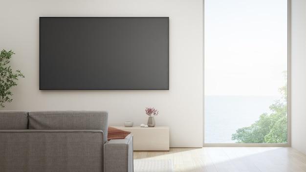 Tv op witte muur tegen sofa in huis of villa. Premium Foto