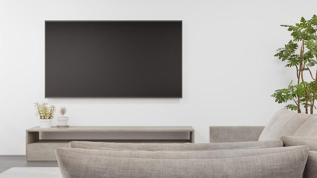 Tv-standaard op betonnen vloer van lichte woonkamer en bank tegen televisie in moderne woning of appartement. Premium Foto