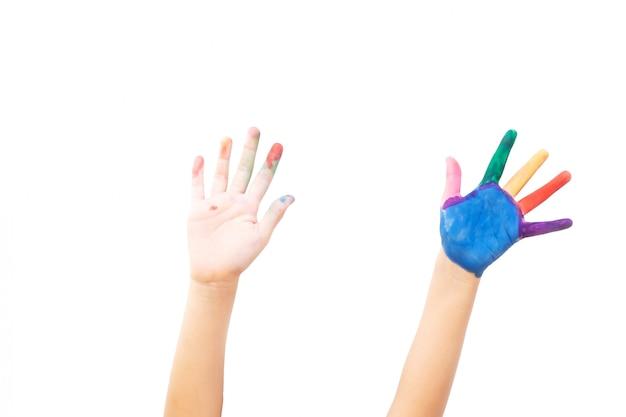 Twee handen verschijnen op witte isoleren. verfkleur op linkerhand en vinger. kunst activiteit. Premium Foto