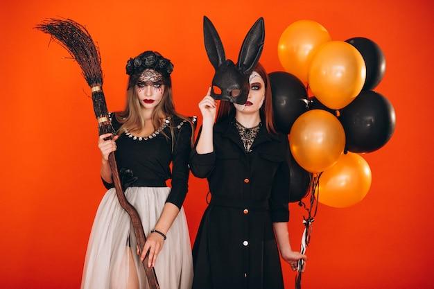 Twee meisjes in halloween-kostuums Gratis Foto