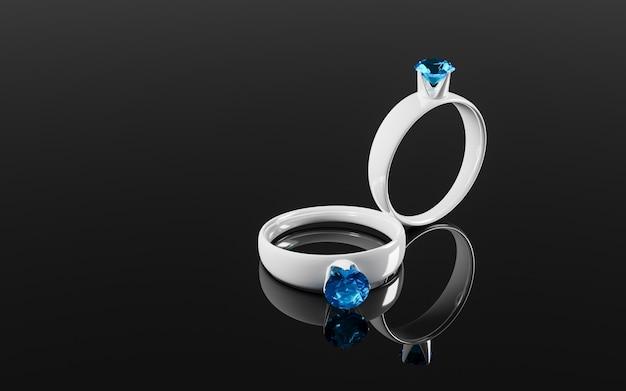 Twee ringen in witgoud met blauwe of blauwe diamanten worden weerspiegeld op het spiegeloppervlak. Premium Foto