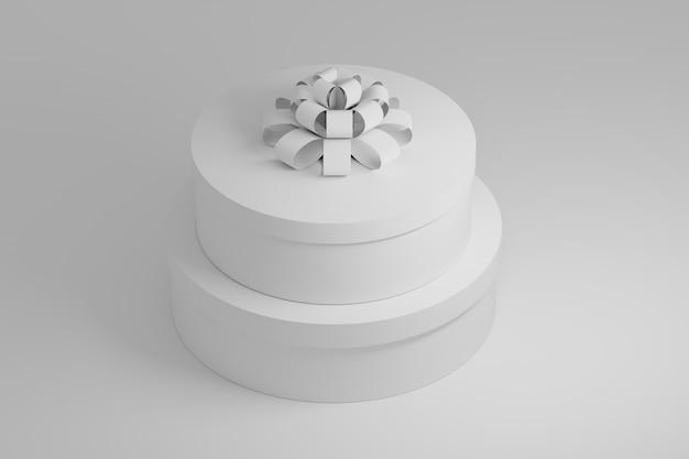 Twee witte ronde geschenkdozen met een doos op wit. 3d-afbeelding. Premium Foto