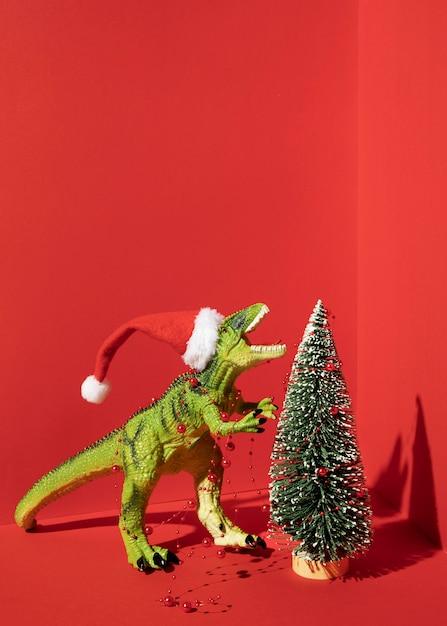 Tyrannosaurus rex speelgoed met kerstboom Premium Foto