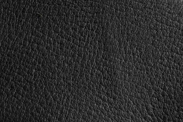 Uiterst close-up zwart leer textuur achtergrond oppervlak Gratis Foto
