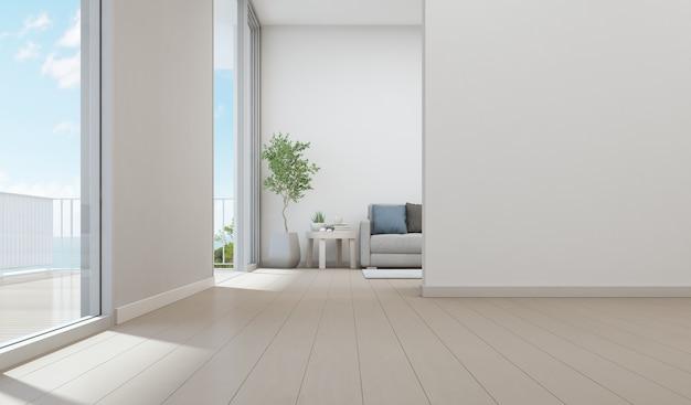 Uitzicht op zee woonkamer van luxe strandhuis met kamerplant in de buurt van glazen deur en houten te Premium Foto