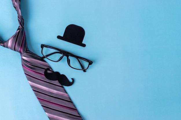 Vaderdag concept. zwart teken van hoed, snor, bril, stropdas Premium Foto