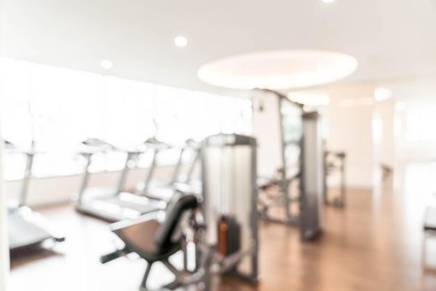 Van achtergrond onduidelijk beeldgymnastiek geschiktheidscentrum of gezondheidsclub met sporten oefeningsmateriaal Premium Foto