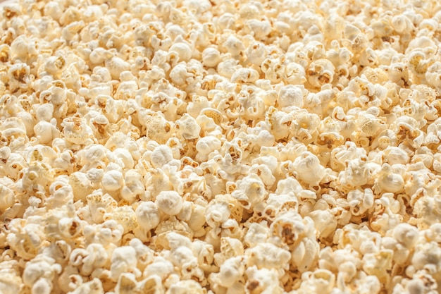 Van de achtergrond popcorn bpopcorn bokeh textureokeh textuur. Premium Foto