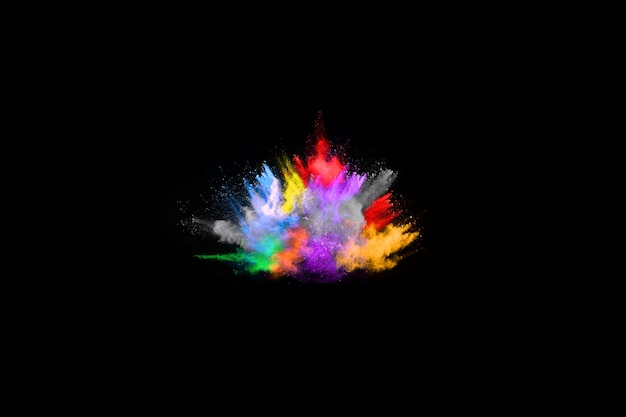Veelkleurige poederexplosie op zwarte achtergrond. Premium Foto