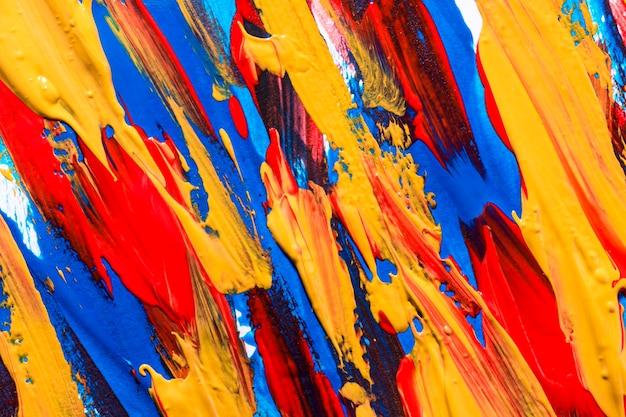 Veelkleurige verf penseelstreken op het oppervlak Gratis Foto