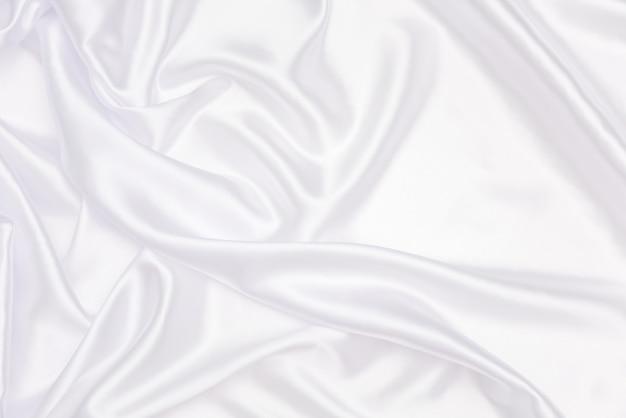 Verfrommeld van wit satijn voor abstract en design Premium Foto