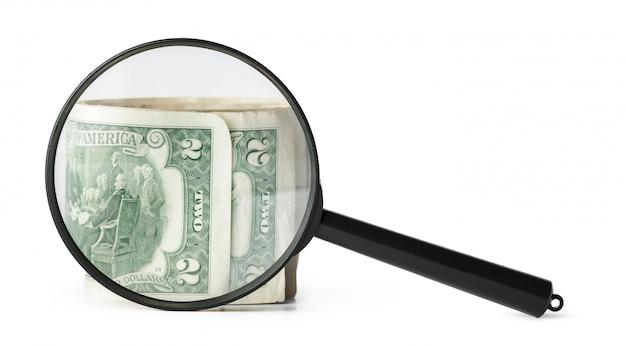 Vergrootglas en dollars Premium Foto
