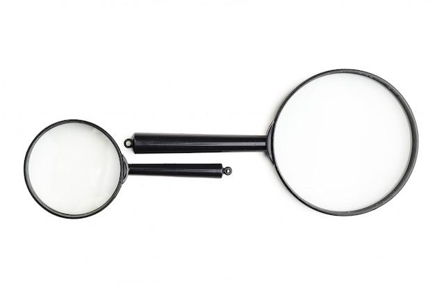 Vergrootglas op het wit wordt geïsoleerd dat Premium Foto