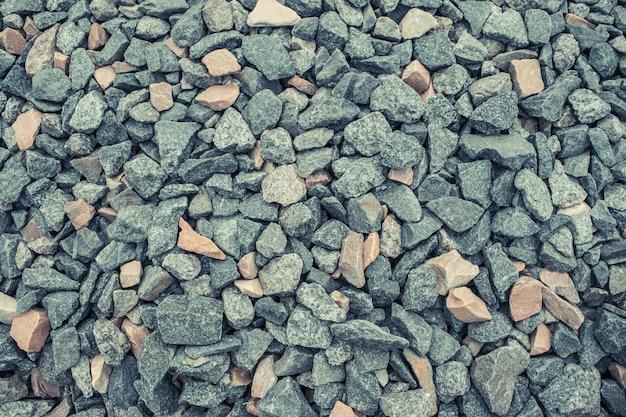 Verpletterd grind als achtergrond of textuur. achtergrond van granietgrind. Premium Foto