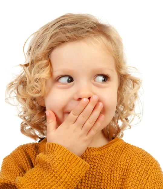 Verrast blond kind met blauwe ogen Premium Foto