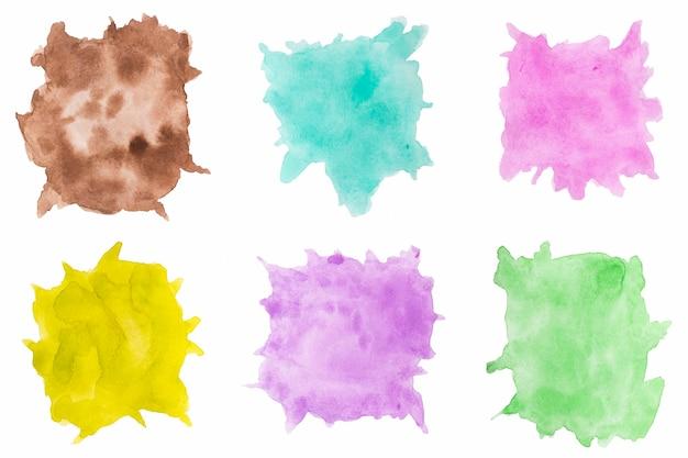 Verscheidenheid van aquarel spatten op witte achtergrond Gratis Foto