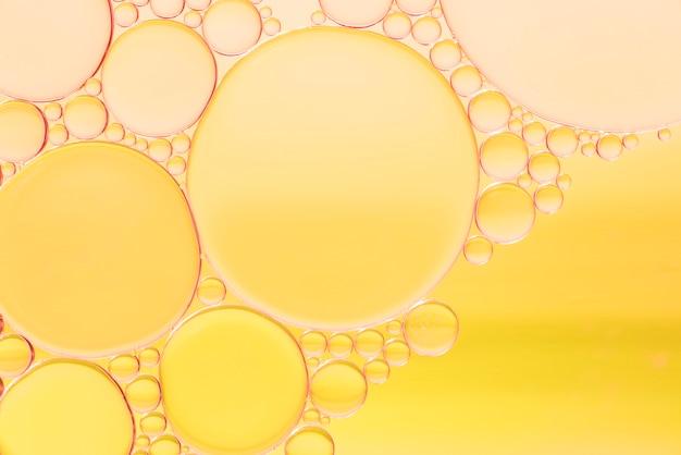 Verscheidenheid van gele abstracte bellentextuur Gratis Foto