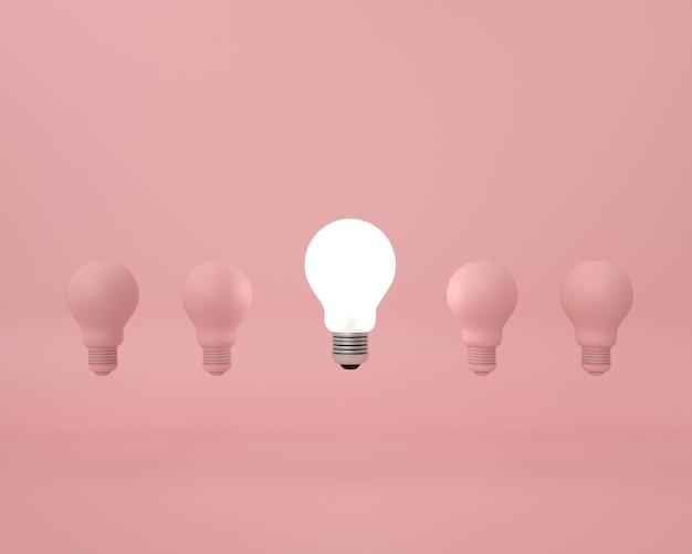 Verschil gloeilamp op roze. minimaal creatief idee concept. Premium Foto